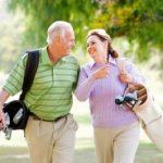 older couple golfing