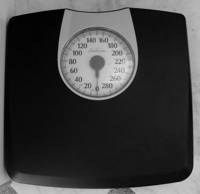 Use a scale to track pounds gained or lost